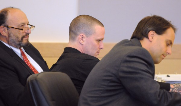 Jason Trickett (center) with his attorneys Marvin Glazier (left) and Hunter Tzovarras during the first day of his trial at the Penobscot Judicial Center in Bangor Monday. Trickett is charged with manslaughter for the death of Andy Smith on First Street on May 22, 2012.