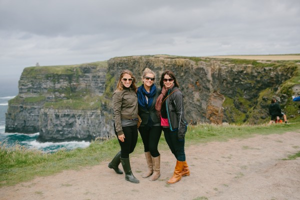 Portland photographer Emily Delamater, center, poses with sisters Sarah Carter Hill and Jessica Person by the Cliffs of Moher during a July trip to Ireland. Delamater won the trip in a photo contest in March.