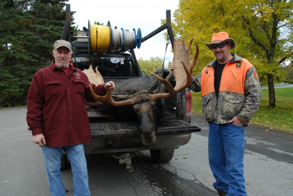 Shapleigh hunter Chris Kessler, right, tagged this 1,010-pound bull moose Monday evening, the first day of the first week of Maine's annual moose hunt. Hunting with Kessler was his sub-permittee Charlie Plante of Springville. The two were at the Fort Kent tagging station Tuesday afternoon.