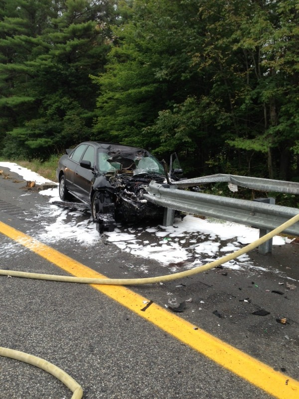 Police say this car rammed into an Interstate 295 guardrail and caught fire Tuesday.