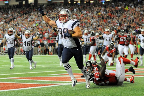 New England Patriots tight end Matthew Mulligan (88) reacts after catching a touchdown pass behind  Atlanta Falcons safety William Moore (25) and linebacker Akeem Dent (52) during the second quarter Sunday night at the Georgia Dome in Atlanta. It was the second NFL touchdown for Mulligan, an Enfield, Maine, native.