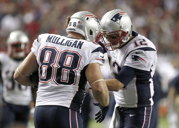 New England Patriots tight end Matthew Mulligan (88) celebrates with quarterback Tom Brady (12) after scoring a touchdown in the first half against the Atlanta Falcons during their game Sunday night in Atlanta. It was the second NFL touchdown for Mulligan, an Enfield, Maine, native.
