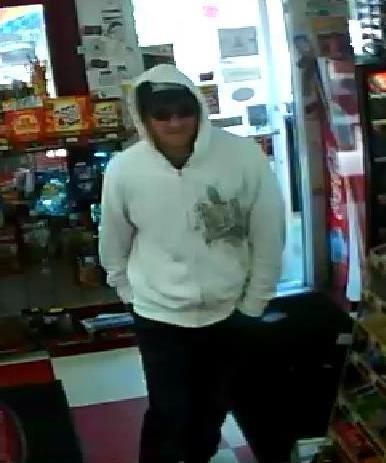 An additional surveillance image of the suspect wanted in a Glenburn armed robbery was unveiled by state police Tuesday.