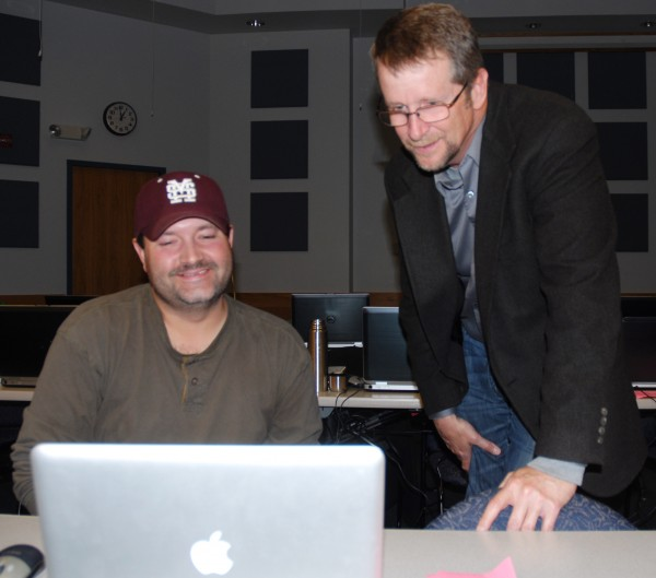 Ameridial Vice President for Healthcare Services Michael McCarthy spends a few moments with new Fort Kent branch employee Mike Ecker during this week's training session at the University of Maine at Fort Kent. When fully up and running, the new call center will have 90 full time employees.