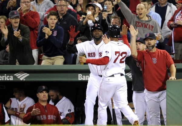 Boston's Xander Bogaerts (72) is met by his teammates after scoring in the seventh inning against the New York Yankees at Fenway Park in Boston Sunday night.