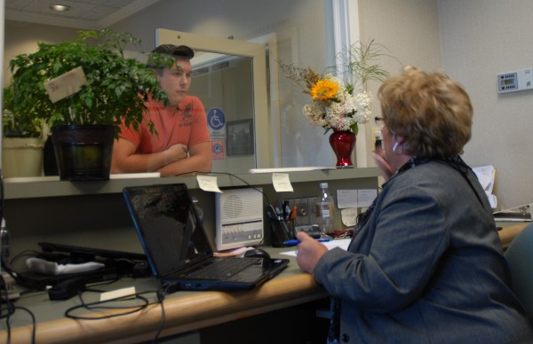 Ameridial Fort Kent Office Manager Karen Deprey talks to an applicant at the call center's facility. When fully operational by Oct. 1, the center will employ 90 people.