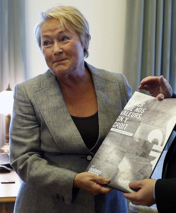 Quebec's Premier Pauline Marois holds the Quebec Charter of Values during a photo-op at the National Assembly in Quebec City, September 10, 2013.