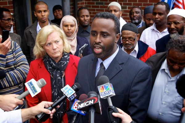 U.S. Rep. Chellie Pingree, D-Maine, listens to Deering High School teacher and Portland Somali community leader Abdullahi Ahmed speak outside the Islamic Society of Portland Tuesday as he dismissed any terrorism links between Portland and al Shabab.