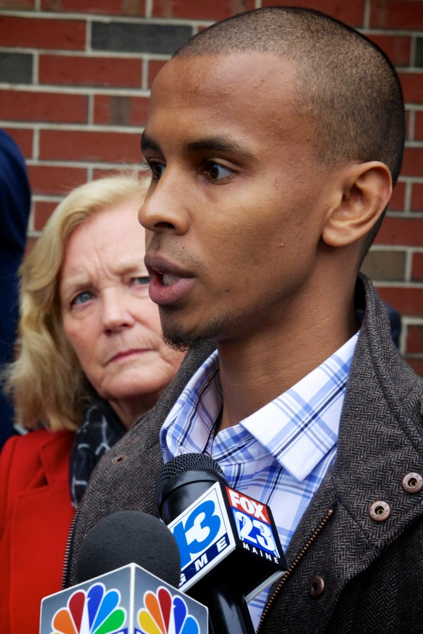 U.S. Rep. Chellie Pingree, D-Maine, listens to Portland resident Mohamed Yusuf Mohamed, 24, speak to reporters outside the Islamic Society of Portland Tuesday. Mohamed said he was not aware of any terrorism recruitment going on in Portland's Somali community.