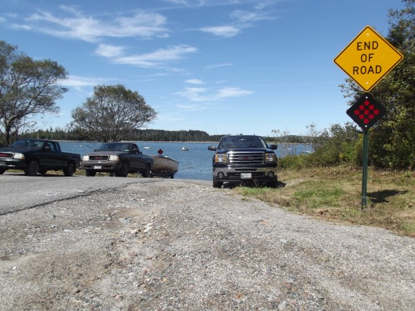 A warning sign marks the descent onto the boat ramp at Roque Bluffs State Park.