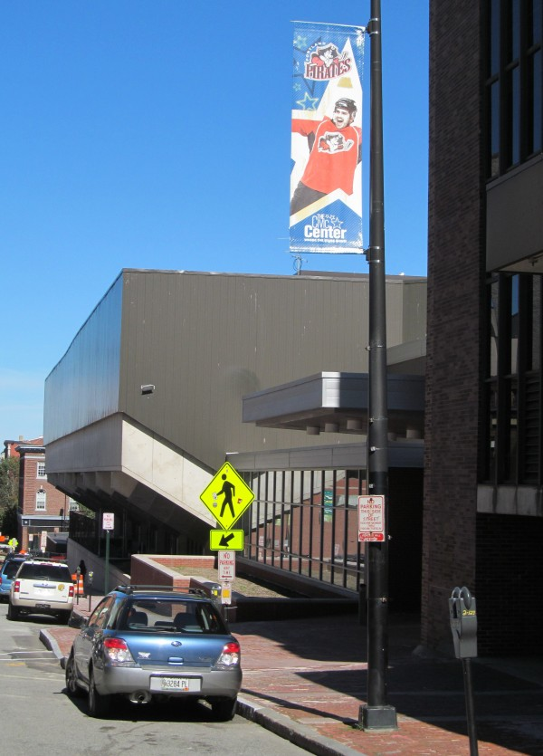A street banner hanging outside the Cumberland County Civic Center celebrates the venue's relationship with the Portland Pirates professional hockey team. The team filed a lawsuit against the civic center Friday.