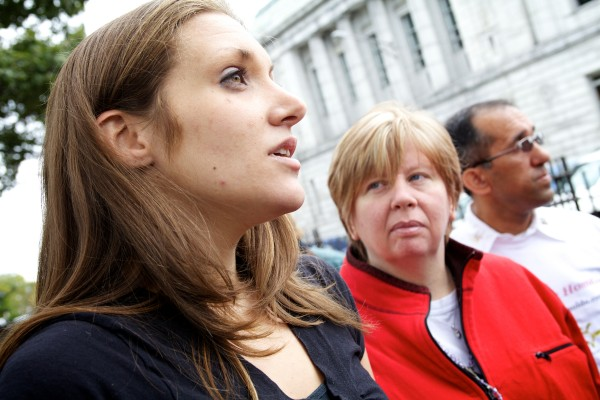Trista Reynolds, mother of missing toddler Ayla Reynolds, her stepmother Frankie Maines (center) and her father Ron Reynolds talk to the press outside the Cumberland County Courthouse in Portland Wednesday.
