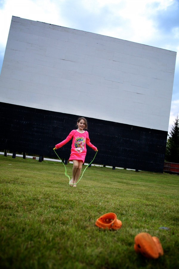 Leaving her shoes behind, Danielle Gagnon, 8, skips rope before the movies start at the Bridgton Twin Drive-In.