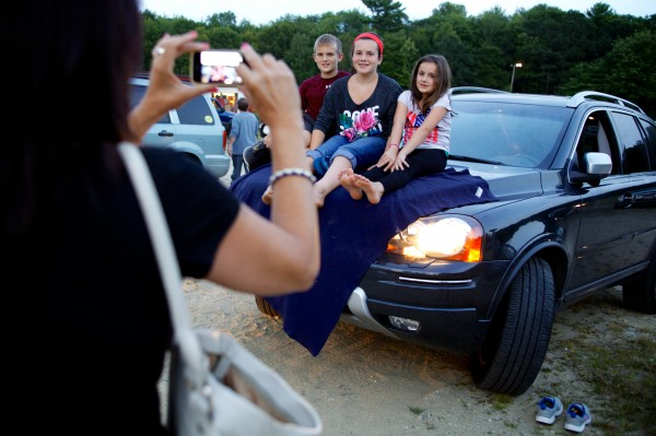 The Carrieri siblings (from left) Christian, 10, Jenna, 12, and Marina, 7, get their picture taken at Westbrook's Prides Corner Drive-In.