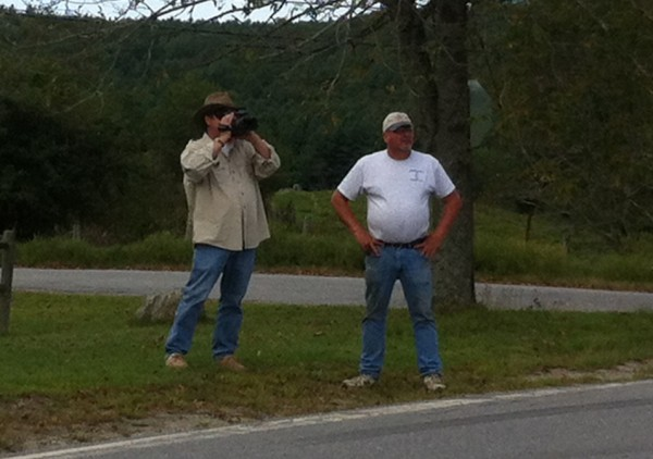 Filmmaker Keith O'Leary (left) documents the raising of the new &quotCowshit Corner&quot sign with Dyer Valley Farm owner Larry Russell.