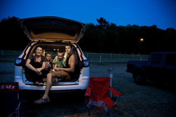 The Estes family (from left) Nichole, Grace, 5, Kyle, 8, and Matthew wait for the start of a double feature at Westbrook's Prides Corner Drive-In. The open-air theater opened in 1952 on what used to be the Pride family farm.