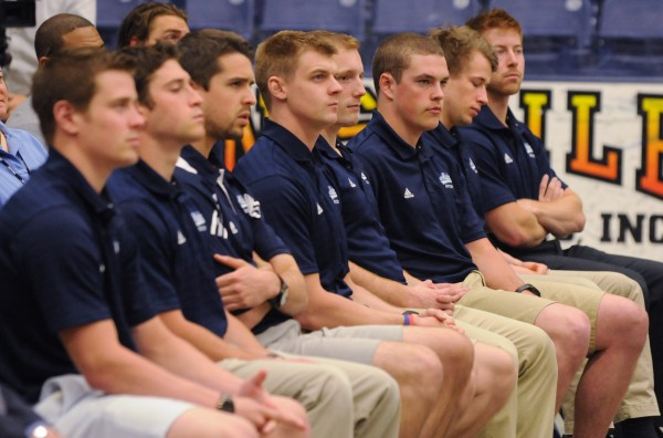 """Members of the University of Maine hockey team sit and listen as newly hired head hockey coach Dennis """"Red"""" Gendron address a small group at Alfond Arena in Orono last May. The team was picked to finish eighth this season in a preseason Hockey East coaches poll released Tuesday."""