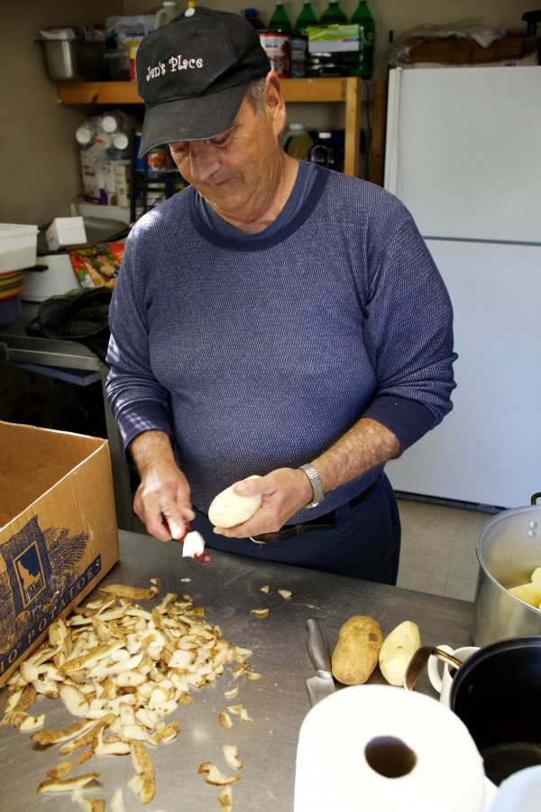 Randy Miller peels potatoes for homefries at Jen's Place in Brunswick Tuesday. The eatery, known for its eccentric clientele and staff, may soon get its own reality television show.