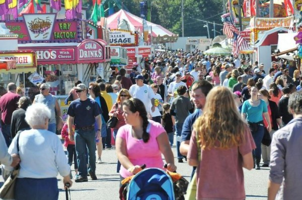 The Cumberland Fairgrounds midway is packed with people on Sept. 23, 2012, the opening day of that year's Cumberland County Fair.