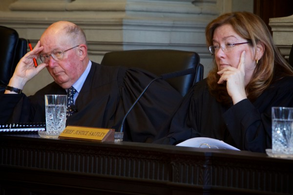 Chief Justice Leigh Saufley (right) and Justice Donald Alexander of the Maine Supreme Judicial Court listen to the appeal Monday in Portland of a 23-year-old man sentenced last June to three life terms in prison for killing three people in a rural home in Amity in June 2010.
