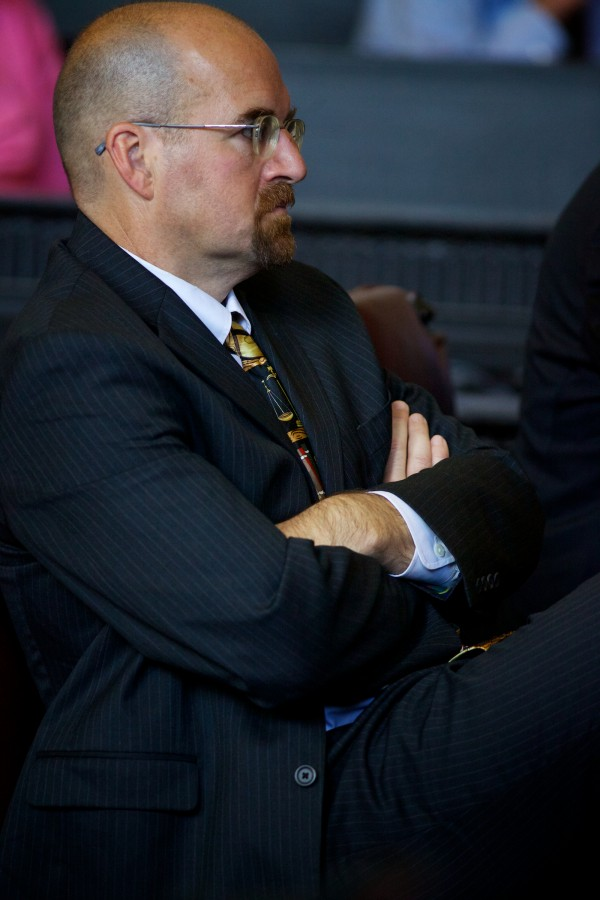 Assistant Attorney General Donald Macomber listens at the Maine Supreme Judicial Court Monday in Portland during arguments in the appeal of a 23-year-old man sentenced last June to three life terms in prison for killing three people in a rural home in Amity in June 2010.