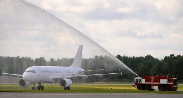 The first Allegiant Air Airbus aircraft that landed at the Bangor International Airport receives a water salute July 30, 2013. The Allegiant airline recently announced that a compliance issue was discovered that will require inspection and overhaul of several slides in its MD80 fleet.
