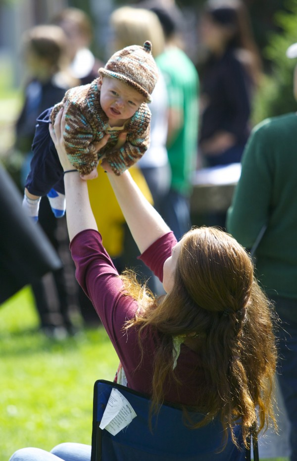 Alorah Gellerson holds her baby during a protest against DHHS on Thursday.