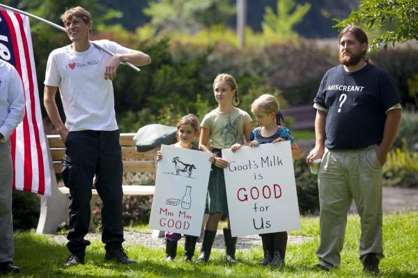 From left, Raphael Radnai, Emma Perry - St. Peter, 5, Luna Perry - St.Peter, 9, Carolyn Retberg, 8, and Paul McCarrier attended a rally in support of Alorah Gellerson Thursday morning at Cascade Park in Bangor. Gellerson fed her baby goat's milk and was reported to DHHS.
