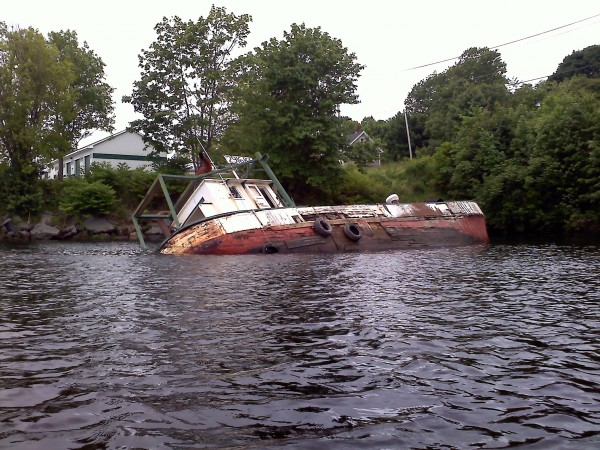 The Roamer, which ran ashore in a cove of the Penobscot River near the Bangor-Hampden town line in July 2011, remains stuck in the mudflat more than two years later. A state official says the boat is available for salvage.