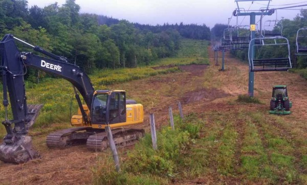 Nortrax of Bangor has donated the use of a John Deere excavator and Adam Moscovitz of Bangor brought his tractor to Squaw Mountain to help rebuild the trails and cut brush this summer.