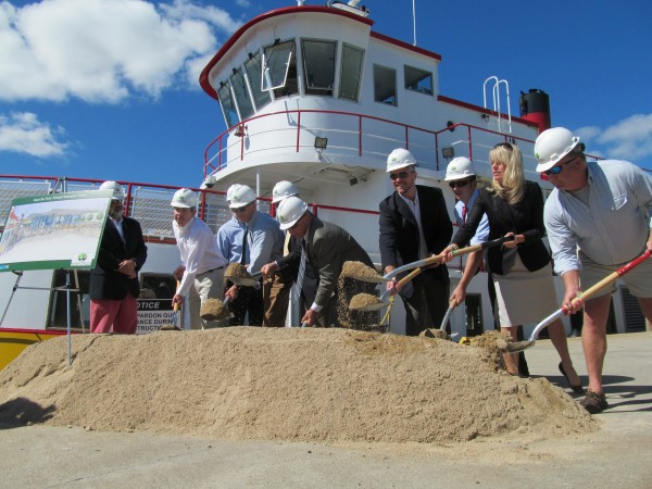 Portland city leaders join representatives from Casco Bay Lines, Scott Simons Architects, Landry/French Construction Co. and the offices of Maine's congressional delegation members Wednesday morning for the ceremonial groundbreaking for a $2.5 million renovation of the city ferry terminal.