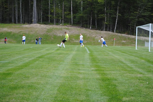 Lee Academy players warm up on their new soccer field before the first game on the new field on Sept. 10 against Piscataquis Community of Guilford.