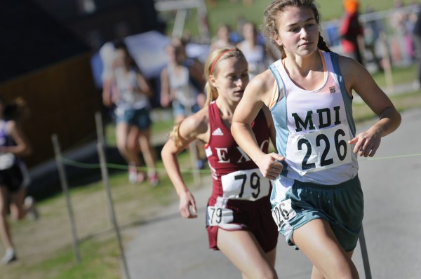 Mount Desert Island's Maggie Painter (right) and Ellsworth's Aleta Looker compete in last season's Penobscot Valley Conference championships in Ellsworth. Painter is one of five top returning runners for the Trojans this season.