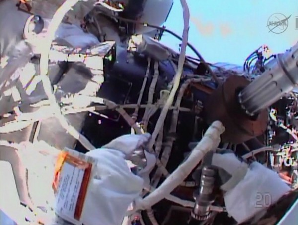 Flight engineer Chris Cassidy routes cables outside the International Space Station during an Expedition 36 spacewalk in this NASA handout image taken from NASA TV released to Reuters on July 9, 2013.