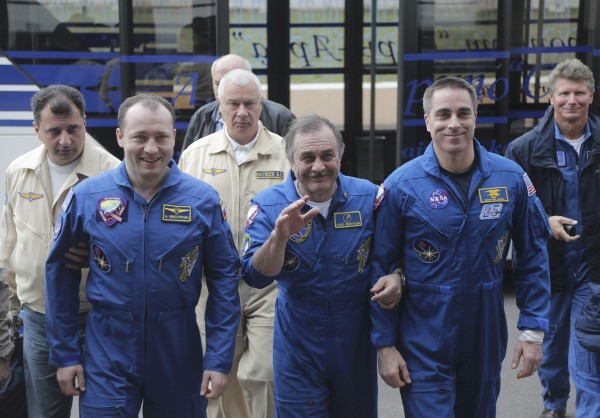 Russian cosmonauts Alexander Misurkin (L) and Pavel Vinogradov (C) and US astronaut Chris Cassidy (R) arrive a press conference at the airport in Karaganda, Kazakhstan, Sept. 11, 2013.