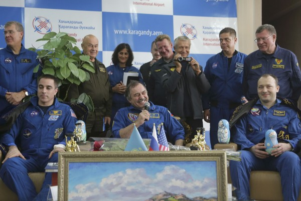 Russian cosmonauts Alexander Misurkin (R) and Pavel Vinogradov (C) and US astronaut Chris Cassidy (L) attend a press conference at the airport in Karaganda, Kazakhstan, Sept. 11, 2013.