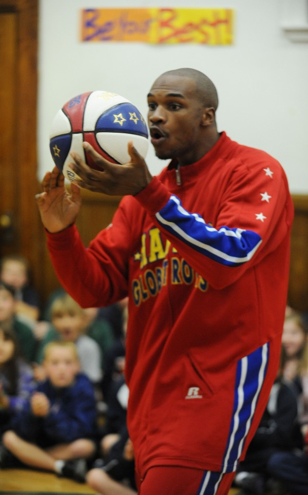 Harlem Globetrotter Jet Williams displays his ball-handling talents during an anti-bullying session at All Saints Catholic School in Bangor on Monday.