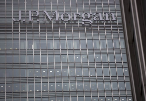 A sign is seen on the Canary Wharf offices of JP Morgan in London on Thursday, Sept. 19. The &quotLondon Whale&quot trading scandal, once dismissed by JPMorgan Chase & Co. CEO Jamie Dimon as a &quottempest in a teapot,&quot is costing the largest U.S. bank $920 million in penalties and a rare admission of wrongdoing.