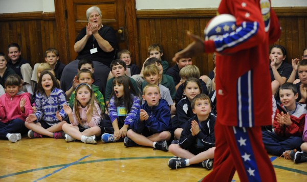 Students at All Saints Catholic School react to Harlem Globetrotter Jet Williams during an anti-bullying session conducted by Williams on Monday at the Bangor school.