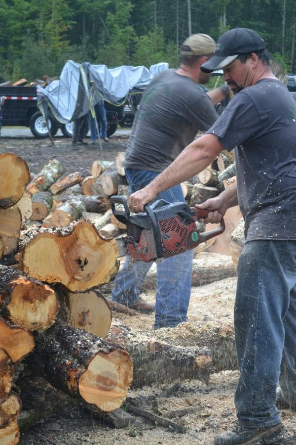 Mark Erskine of Dixmont, an employee of Gary Pomeroy Logging Inc. of Hermon, spent Sunday in Holden with about 50 others from the company and other businesses in the region -- including competitors -- helping Pomeroy employee Rick Whitmore cut and deliver firewood for his side business. Whitmore is fighting nasal cancer and has been unable to work either job.