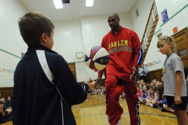 Harlem Globetrotter Jet Williams interacts with All Saints Catholic School students, Samantha Warren (right) and Noah Jones during an anti-bullying public session conducted by Williams on Monday at the Bangor school.