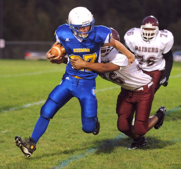 Hermon High School's David Shepardson scrambles for more yardage before being tackled by Washington Academy's Thehon Fox during a game in 2011. Shepardson, a halfback, is back for his junior season after leading the LTC in rushing in 2012 with 1,416 yards.