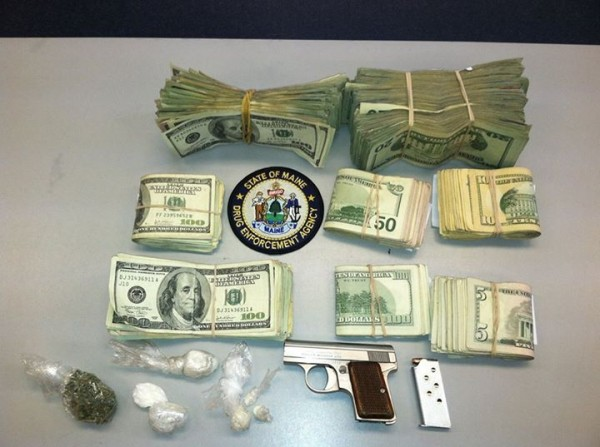 Cocaine, heroin, cash and a loaded gun allegedly seized during a Sept. 19 drug raid in Biddeford.