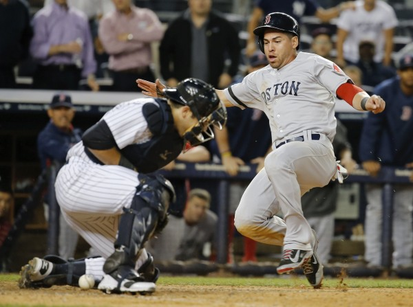 Boston's Jacoby Ellsbury scores at home  as New York Yankees catcher Austin Romine cannot hold the throw during their game on Sept. 5 in New York.