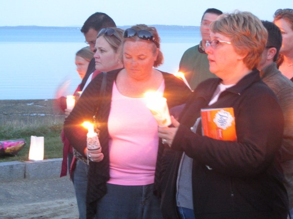 More than 150 people turned out Friday night to remember Lynn Arsenault at a vigil held in Belfast.
