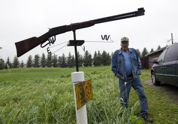 Malcolm Wadsworth, 82, checks on his rifle weather vane on a pole next to his driveway in Union.