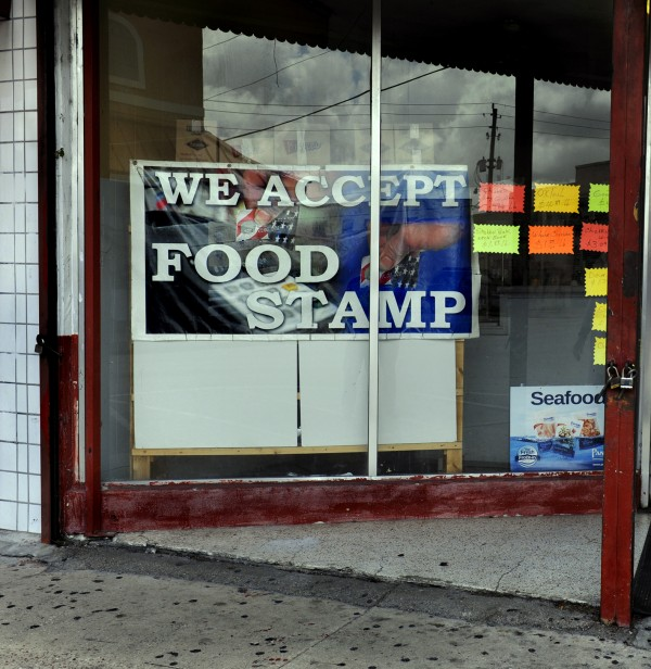 A store in Belle Glade, Fla., advertises its participation in the federal food stamp program on Aug. 14, 2013.