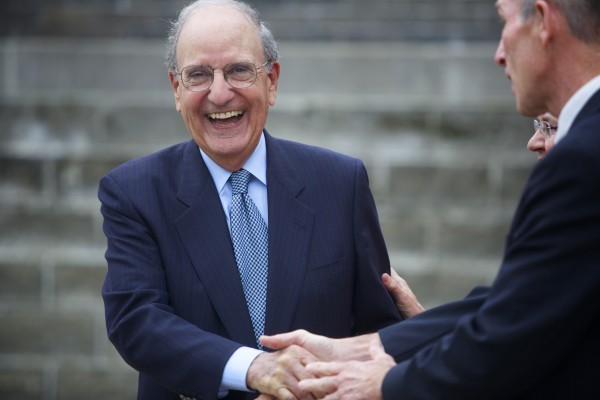 Former U.S. Sen. George Mitchell shakes hands with David Hart, the Director of the Senator George Mitchell Center at UMaine, after Mitchell spoke at UMaine Wednesday about sustainability.