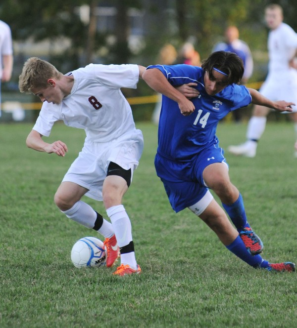 Bangor's Carson Atherley and Messalonskee's Brandon Nale battle in the second half at the Bangor High field Monday. Bangor beat the Eagles of Oakland 3-2 in overtime.