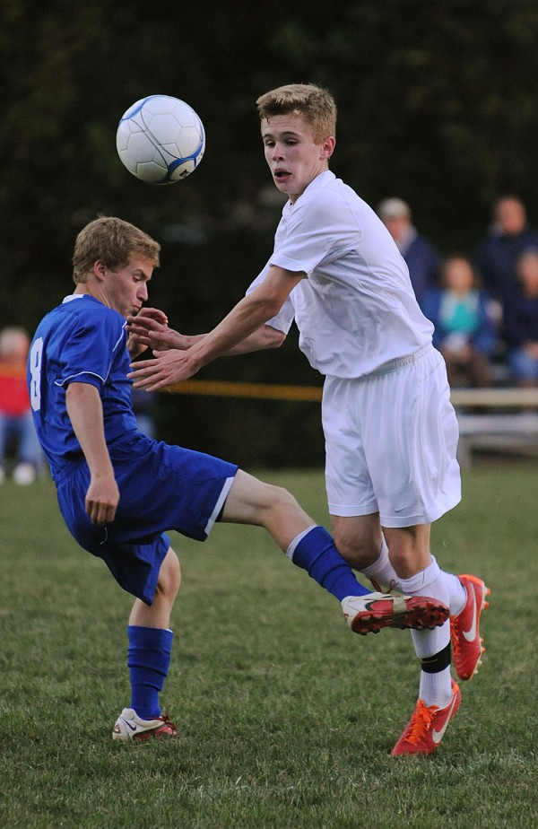 Bangor's Carson Atherley gets tripped by Messalonskee's Quinn Warren during second-half action at Bangor on Monday. Bangor won 3-2 in overtime.